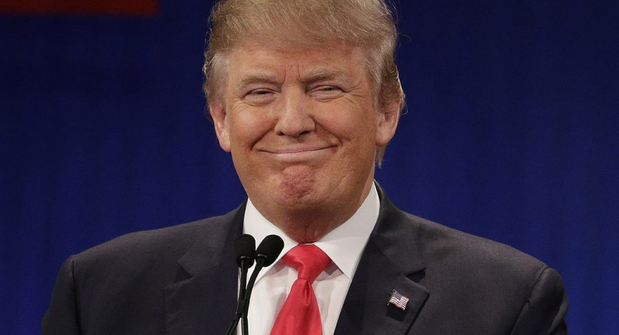 Republican presidential candidate, businessman Donald Trump stands during the Fox Business Network Republican presidential debate at the North Charleston Coliseum, Thursday, Jan. 14, 2016, in North Charleston, S.C. (AP Photo/Chuck Burton)