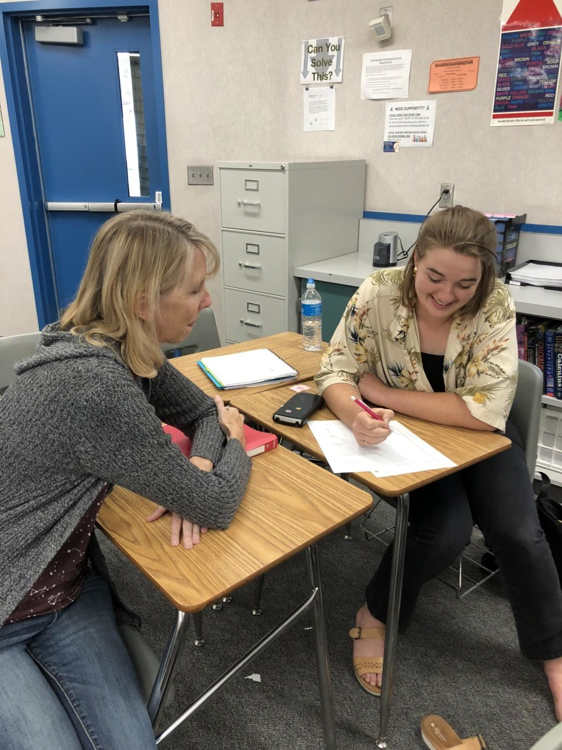Mrs. Tara McCullough helps a calc BC student during class.
