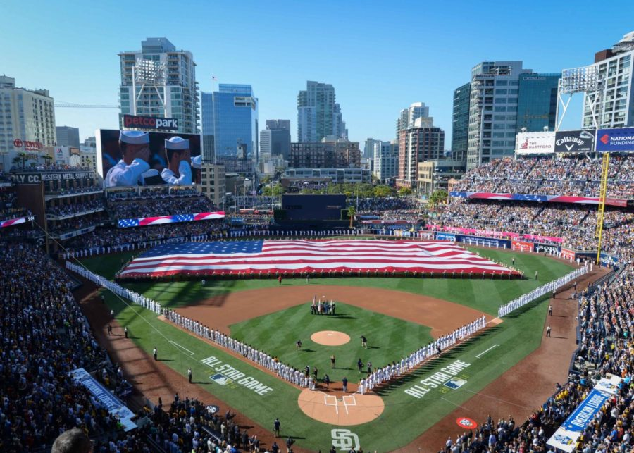 160712-N-NV908-496 SAN DIEGO (July 12, 2016) Sailors man the rails while Marines hold up the American flag during the pre-game ceremony of the 2016 Major League Baseball All-Star Game at Petco Park. Sailors from the aircraft carrier USS Theodore Roosevelt (CVN 71) and Marines from the 3rd Marine Aircraft Wing joined together to participate in a salute to the United States Armed Forces. (U.S. Navy photo by Mass Communication Specialist 3rd Class Chad M. Trudeau)