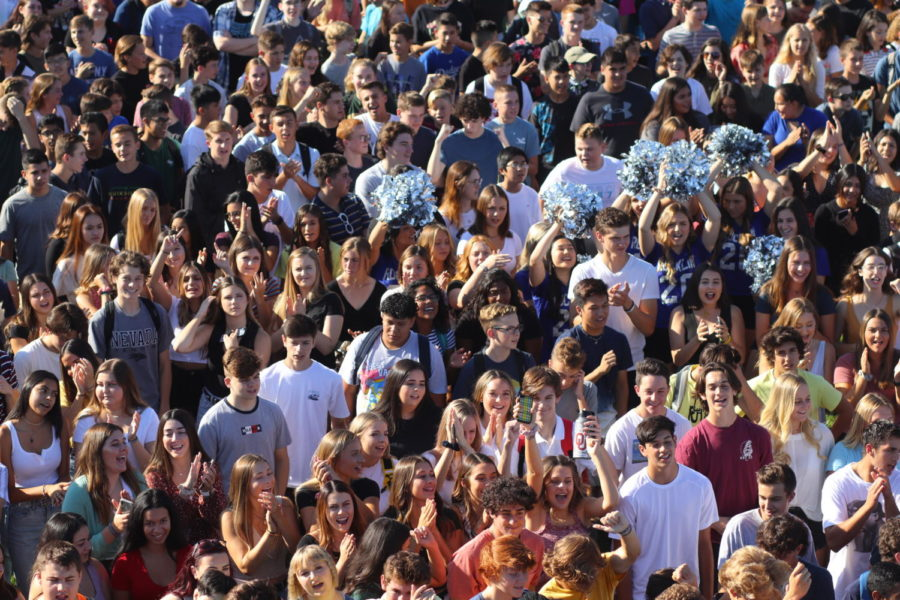 Students gather on the soccer field after the Welcome Back Assembly.  Captured by Jack Goodman.