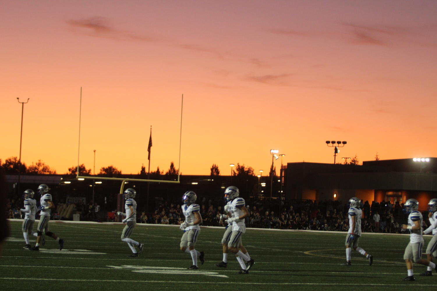 Rocklin football players play just after sunset at Whitney High School  photo by Karine Nguyen